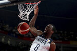 United States' Harrison Barnes dunks against Greece during phase two of the FIBA Basketball World Cup at the Shenzhen Bay Sports Center in Shenzhen in southern China's Guangdong province on Saturday, Sept. 7, 2019. United States beats Greece 69-53. (AP Photo/Ng Han Guan)