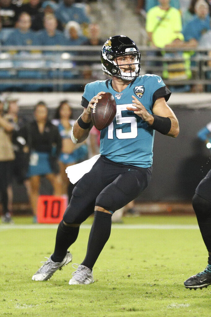 Jacksonville Jaguars quarterback Gardner Minshew (15) looks downfield for a receiver in an NFL game against the Tennessee Titans, Thursday, Sept. 19, 2019, in Jacksonville, Fla. The Jaguars defeated the Titans 20-7. (Margaret Bowles via AP)