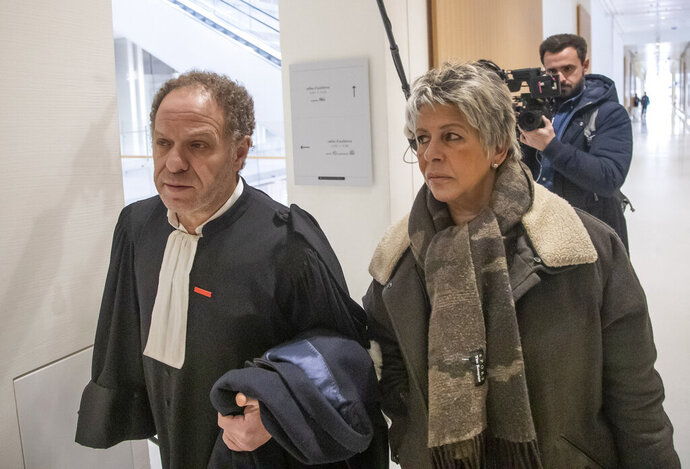 Mehana Mouhou lawyer representing the victims representing the victims of French writer Gabriel Matzneff, left, and child rights activist Latifa Bennari arrives at Paris' court house, Wednesday, Feb. 12, 2020. The legal woes of 83-year-old once celebrated writer, Gabriel Matzneff, are mounting, with a police investigation opened for rape of minors and a new case brought by an NGO for actively promoting pedophilia in recent articles in which he defended an affair decades ago with an underaged girl. (AP Photo/Michel Euler)