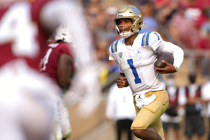 UCLA quarterback Dorian Thompson-Robinson (1) runs for a touchdown against the Stanford during the first half of an NCAA college football game Saturday, Sept. 25, 2021, in Stanford, Calif. (AP Photo/Tony Avelar)