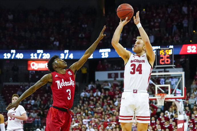 Wisconsin's Brad Davison (34) shoots against Nebraska's Shamiel Stevenson (4) during the second half of an NCAA college basketball game Tuesday, Jan. 21, 2020, in Madison, Wis. Davison had a team-high 14 points in Wisconsin's 82-68 win. (AP Photo/Andy Manis)