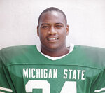 FILE - This is a 1987 file photo showing Michigan State NCAA college football player Lorenzo White. Newly elected College Football Hall of Famers Darren McFadden, Vince Young and Lorenzo White never won the Heisman Trophy. Each was up for the award at a time when their credentials didn't quite fit the voting trends. (AP Photo/File)