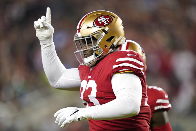 San Francisco 49ers defensive tackle D.J. Jones (93) celebrates after sacking Seattle Seahawks quarterback Russell Wilson during the first half of an NFL football game in Santa Clara, Calif., Monday, Nov. 11, 2019. (AP Photo/Tony Avelar)