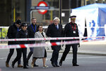 Britain's Prime Minister Boris Johnson, second right, Home Secretary Priti Patel, center, and Metropolitan Police Commissioner, Cressida Dick, second left, attend the scene in central London, Saturday, Nov. 30, 2019, after an attack on London Bridge on Friday. UK counterterrorism police on Saturday searched for clues into how a man imprisoned for terrorism offenses before his release last year managed to stab several people before being tackled by bystanders and shot dead by officers on London Bridge. Two people were killed and three wounded. (Steve Parsons/PA via AP)
