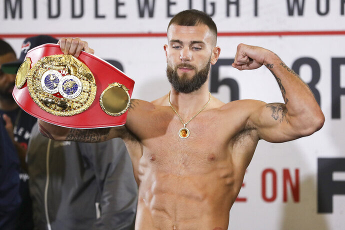 IBF super middleweight champion Caleb Plant poses during the weigh-in for his fight against Vincent Feigenbutz Friday, Feb. 14, 2020, in Nashville, Tenn. The fight is scheduled for Saturday, Feb. 15. (AP Photo/Mark Humphrey)