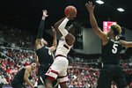 Stanford guard Daejon Davis (1) drives against Colorado guard Shane Gatling (0) during the first half of an NCAA college basketball game in Stanford, Calif., Sunday, March 1, 2020. (AP Photo/Jed Jacobsohn)