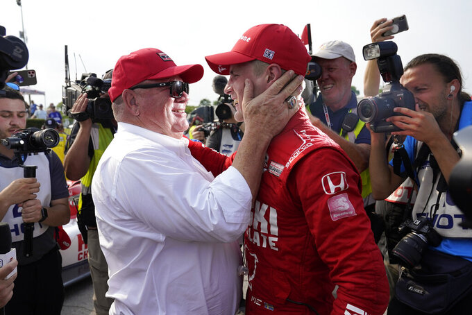 Marcus Ericsson, right, of Sweden, celebrates with team owner Chip Ganassi after winning the first race of the IndyCar Detroit Grand Prix auto racing doubleheader on Belle Isle in Detroit, Saturday, June 12, 2021. (AP Photo/Paul Sancya)