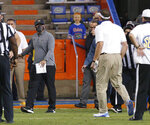 Missouri coach Eliah Drinkwitz, left, and Florida coach Dan Mullen, right, yell at each other after a fight broke out at the end of the first half of an NCAA college football game in Gainesville, Fla., Saturday, Oct. 31, 2020. (Brad McClenny/The Gainesville Sun via AP)