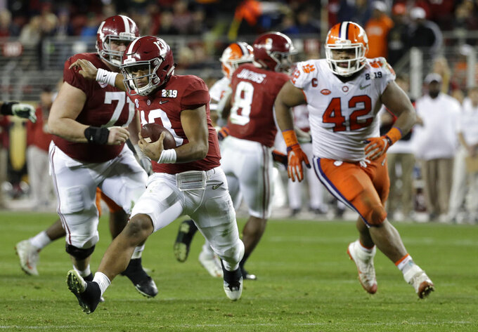 Alabama's Tua Tagovailoa scrambles during the second half of the NCAA college football playoff championship game against Clemson, Monday, Jan. 7, 2019, in Santa Clara, Calif. (AP Photo/David J. Phillip)
