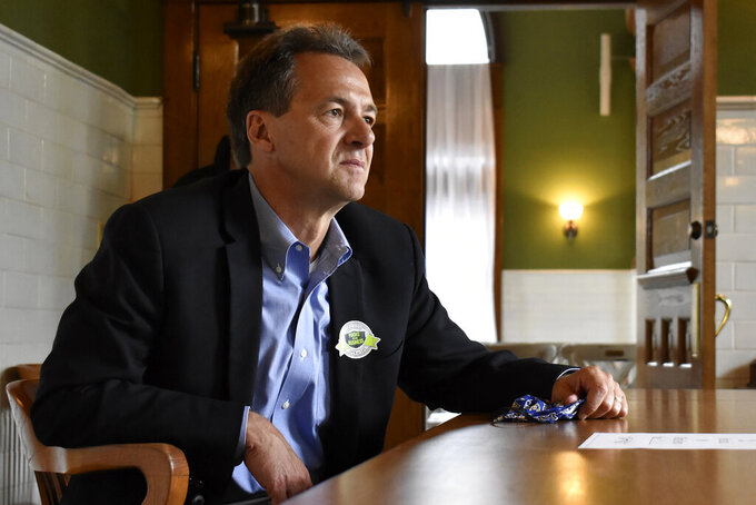 FILE - In this July 24, 2020, file photo, then-Montana Gov. Steve Bullock speaks to members of the business community in Billings, Mont. Republican lawmakers in Montana are pushing a series of bills that would limit abortion access and remove gun restrictions, hoping to capitalize on GOP control following the November election. Montana has a Republican governor for the first time in 16 years, opening the door to pass into law bills previously vetoed by Democratic governors. (AP Photo/Matthew Brown, File)