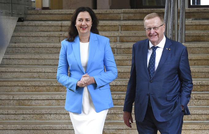 Queensland Premier Annastacia Palaszczuk, left, and AOC President John Coates attend a media conference following news Queensland's bid to host the 2032 Olympics was elevated to preferred bid by the IOC in Brisbane, Australia, Thursday, Feb. 25, 2021. An Australian push to host the 2032 Olympics was elevated overnight to the status of preferred bid, and the people of Brisbane and southeast Queensland state woke up to the news. (Darren England/AAP Image via AP)