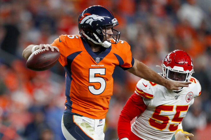 Denver Broncos quarterback Joe Flacco (5) throws as Kansas City Chiefs defensive end Frank Clark (55) pursues during the second half of an NFL football game, Thursday, Oct. 17, 2019, in Denver. (AP Photo/David Zalubowski)
