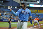 Tampa Bay Rays' Yandy Diaz celebrates after scoring on an RBI single by Manuel Margot against the Baltimore Orioles during the first inning of a baseball game Saturday, June 12, 2021, in St. Petersburg, Fla. (AP Photo/Chris O'Meara)