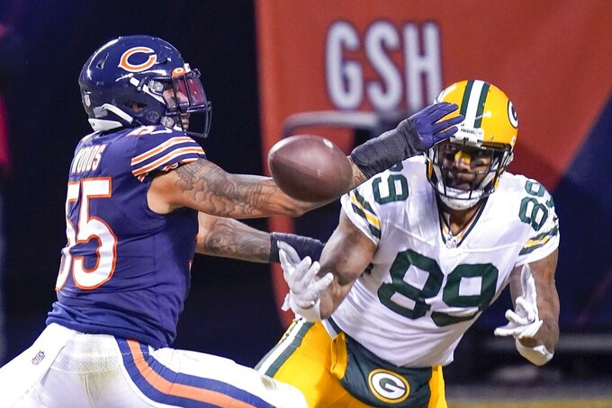 Chicago Bears' Josh Woods breaks up a pass intended for Green Bay Packers' Marcedes Lewis during the first half of an NFL football game Sunday, Jan. 3, 2021, in Chicago. (AP Photo/Charles Rex Arbogast)