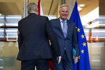 UK Brexit secretary Stephen Barclay, left, is welcomed by European Union chief Brexit negotiator Michel Barnier before their meeting at the European Commission headquarters in Brussels, Friday, Oct. 11, 2019. (AP Photo/Francisco Seco, Pool)