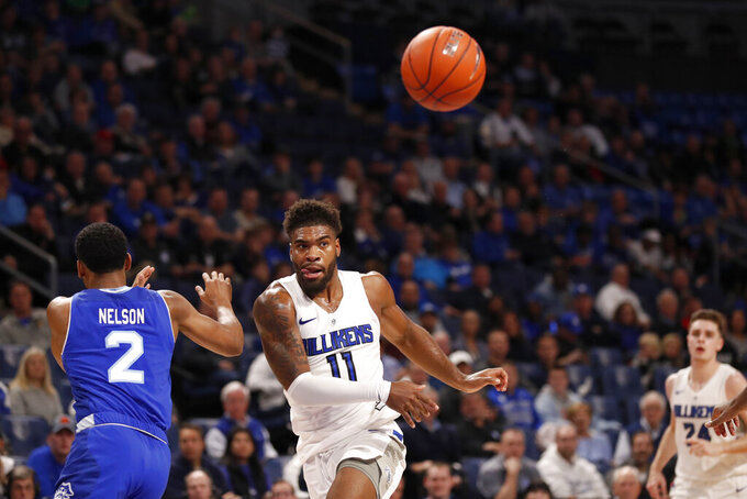 Saint Louis' Hasahn French (11) passes as Seton Hall's Anthony Nelson (2) defends during the second half of an NCAA college basketball game Sunday, Nov. 17, 2019, in St. Louis. (AP Photo/Jeff Roberson)