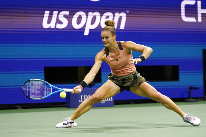 Maria Sakkari, of Greece, hits a forehand to Karolina Pliskova, of the Czech Republic, during the quarterfinals of the U.S. Open tennis tournament Wednesday, Sept. 8, 2021, in New York. (AP Photo/Frank Franklin II)