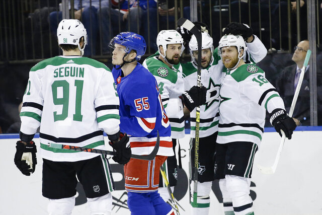 Dallas Stars' Joe Pavelski (16) celebrates with teammates after scoring a goal as New York Rangers' Ryan Lindgren (55) skates away during the first period of an NHL hockey game Monday, Feb. 3, 2020, in New York. (AP Photo/Frank Franklin II)