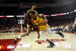 Southern California forward Onyeka Okongwu (21) is defended by Arizona State forward Romello White during the first half of an NCAA college basketball game Saturday, Feb. 29, 2020, in Los Angeles. (AP Photo/Marcio Jose Sanchez)