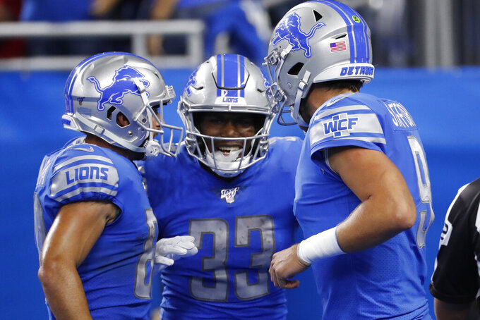 Detroit Lions running back Kerryon Johnson (33) celebrates his 36-yard touchdown reception in the first half of an NFL football game against the Los Angeles Chargers in Detroit, Sunday, Sept. 15, 2019. (AP Photo/Rick Osentoski)