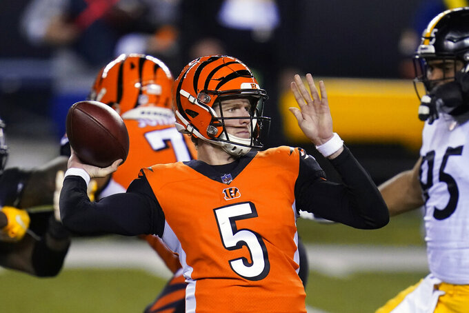 Cincinnati Bengals quarterback Ryan Finley (5) throws during the first half of an NFL football game against the Pittsburgh Steelers, Monday, Dec. 21, 2020, in Cincinnati. (AP Photo/Michael Conroy)