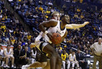 West Virginia forward Derek Culver, front, drives past Lehigh center James Karnik during the second half of an NCAA college basketball game Sunday, Dec. 30, 2018, in Morgantown, W.Va. (AP Photo/Raymond Thompson)