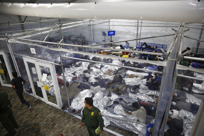 FILE - In this March 30, 2021, file photo, minors inside a pod at the Donna Department of Homeland Security holding facility, the main detention center for unaccompanied children in the Rio Grande Valley run by U.S. Customs and Border Protection (CBP), in Donna, Texas. More Americans disapprove than approve of how President Joe Biden is handling waves of unaccompanied immigrant children arriving at the U.S.-Mexico border, and his efforts on larger immigration policy aren't polling as well as those on other top issues. (AP Photo/Dario Lopez-Mills, Pool)