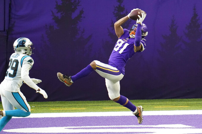 Minnesota Vikings wide receiver Bisi Johnson (81) catches a 2-point conversion over Carolina Panthers cornerback Corn Elder (29) during the second half of an NFL football game, Sunday, Nov. 29, 2020, in Minneapolis. (AP Photo/Jim Mone)