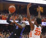 Duke's RJ Barrett, left, shoots next to Syracuse's Elijah Hughes, right, during the first half of an NCAA college basketball game in Syracuse, N.Y., Saturday, Feb. 23, 2019. Duke won 75-65. (AP Photo/Nick Lisi)