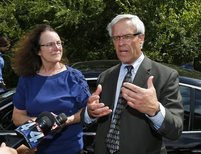 FILE - In this Wednesday, Sept. 16, 2015, file photo, two of Richard Glossip's attorneys, Don Knight, right, and attorney Kathleen Lord, speak with the media in McAlester Okla., after Glossip's execution was stayed. Knight said he's uncovered new evidence in the case. (AP Photo/Sue Ogrocki, File)