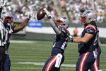 New England Patriots' James White, center, celebrates his touchdown during the first half of an NFL football game against the New York Jets, Sunday, Sept. 19, 2021, in East Rutherford, N.J. (AP Photo/Bill Kostroun)