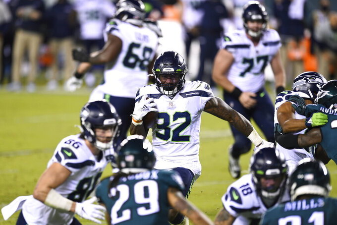 Seattle Seahawks' Chris Carson rushes during the first half of an NFL football game against the Philadelphia Eagles, Monday, Nov. 30, 2020, in Philadelphia. (AP Photo/Derik Hamilton)