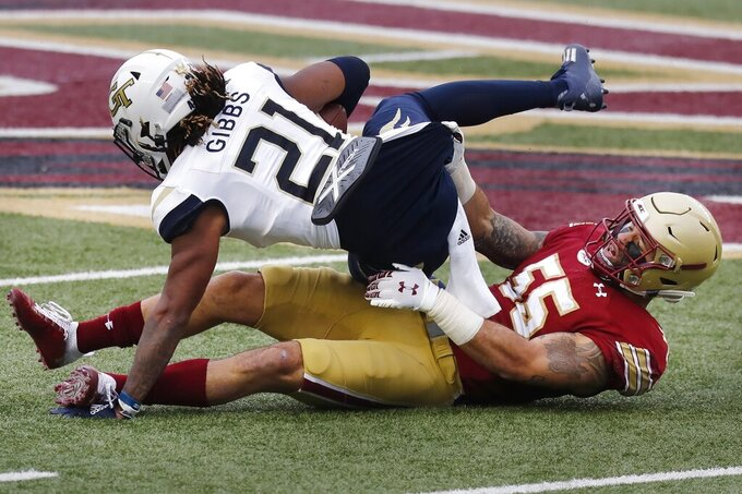 Boston College linebacker Isaiah McDuffie (55) tackles Georgia Tech running back Jahmyr Gibbs (21) during the first half of an NCAA college football game, Saturday, Oct. 24, 2020, in Boston. (AP Photo/Michael Dwyer)