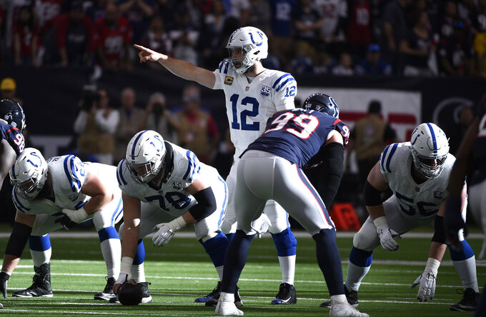 Indianapolis Colts quarterback Andrew Luck (12) signals during the first half of an NFL wild card playoff football game against the Houston Texans, Saturday, Jan. 5, 2019, in Houston. (AP Photo/Eric Christian Smith)