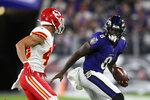 Baltimore Ravens quarterback Lamar Jackson, right, rushes past Kansas City Chiefs defensive back Daniel Sorensen in the first half of an NFL football game, Sunday, Sept. 19, 2021, in Baltimore. (AP Photo/Nick Wass)