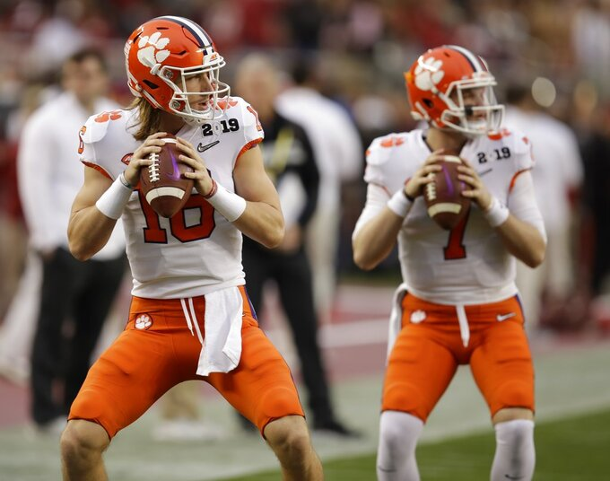 Clemson's Trevor Lawrence and Chase Brice (7) warm up before the NCAA college football playoff championship game against Alabama Monday, Jan. 7, 2019, in Santa Clara, Calif. (AP Photo/Ben Margot)