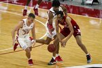 Wisconsin's Brad Davison and Nebraska's Dalano Banton go after a loose ball during the second half of an NCAA college basketball game Tuesday, Dec. 22, 2020, in Madison, Wis. (AP Photo/Morry Gash)