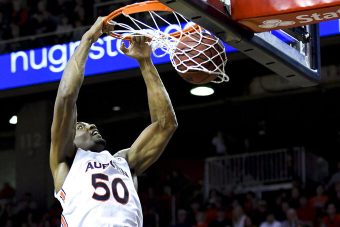 Doughty's 33 leads No. 22 Auburn's 116-70 rout of CSUN