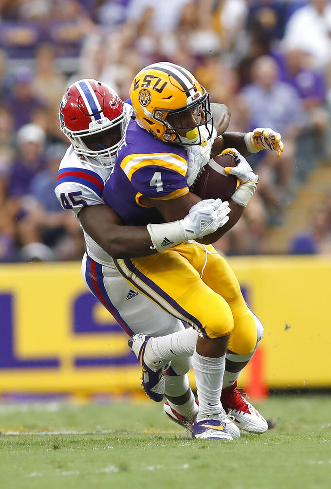 FILE - In this Sept. 22, 2018, file photo, LSU running back Nick Brossette (4) is tackled by Louisiana Tech defensive end Jaylon Ferguson (45) in the first half of an NCAA college football game, in Baton Rouge, La. Ferguson is 1.5 sacks away from tying the all-time NCAA career record held by Terrell Suggs. Louisiana Tech plays against Hawaii in the Hawaii Bowl on Saturday, Dec. 22, 2018. (AP Photo/Tyler Kaufman, File)