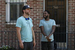"""This image released by Netflix shows director Ricky Staub, left, and Jharrel Jerome on the set of """"Concrete Cowboys."""" (Jessica Kourkounis/Netflix via AP)"""