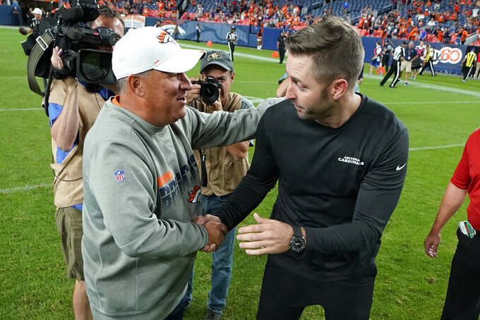 Denver Broncos head coach Vic Fangio, left, greets Arizona Cardinals head coach Kliff Kingsbury after an NFL preseason football game, Thursday, Aug. 29, 2019, in Denver. The Broncos won 20-7. (AP Photo/Jack Dempsey)