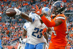FILE - In this Dec. 22, 2019, file photo, Detroit Lions cornerback Darius Slay (23) knocks away a pass in the end zone intended for Denver Broncos wide receiver Courtland Sutton (14) during the second half of an NFL football game, in Denver. The Lions agreed to trade cornerback Darius Slay to the Philadelphia Eagles, ending the standout defensive back's seven-year stint in Detroit. Agent Drew Rosenhaus confirmed the trade Thursday, March 19, 2020, and that Slay has agreed to a three-year, $50 million extension with Philadelphia. (AP Photo/David Zalubowski, File)