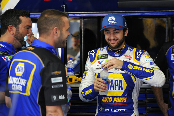 Chase Elliott smiles during practice for Sunday's NASCAR Cup Series auto race at Charlotte Motor Speedway in Concord, N.C., Saturday, Sept. 28, 2019. (AP Photo/Mike McCarn)