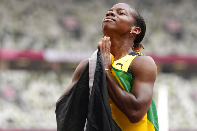 Megan Tapper, of Jamaica, reacts after the women's 100-meters hurdles final at the 2020 Summer Olympics, Monday, Aug. 2, 2021, in Tokyo. (AP Photo/Petr David Josek)