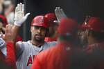 Los Angeles Angels' Albert Pujols is congratulated in the dugout after hitting a solo home run against the Baltimore Orioles in the fourth inning of a baseball game Saturday, May 11, 2019, in Baltimore. (AP Photo/Gail Burton)