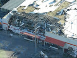 This still image made from video provided by KDFW-Fox 4 in Dallas shows storm damage to a Home Depot store in Dallas on Monday, Oct. 21, 2019. A tornado confirmed by the National Weather Service tore homes and businesses apart in a densely populated area of Dallas, Sunday night, where only minor injuries were reported. (KDFW-Fox 4 via AP)