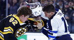 Winnipeg Jets left wing Brandon Tanev, right, loses his helmet during a fight with Boston Bruins center Trent Frederic (82) during the second period of an NHL hockey game in Boston, Tuesday, Jan. 29, 2019. (AP Photo/Charles Krupa)