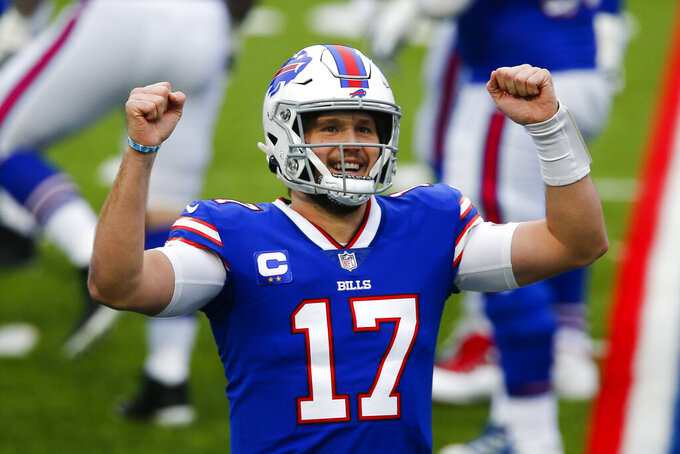 Buffalo Bills quarterback Josh Allen (17) reacts after throwing a touchdown pass in the first half of an NFL football game against the Miami Dolphins, Sunday, Jan. 3, 2021, in Orchard Park, N.Y. (AP Photo/John Munson)