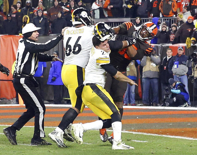 FILE - In this Nov. 14, 2019, file photo, Cleveland Browns defensive end Myles Garrett (95) hits Pittsburgh Steelers quarterback Mason Rudolph (2) with a helmet during the second half of an NFL football game in Cleveland. Suspended Browns star defensive end Myles Garrett met Monday, Feb. 10, 2020, with NFL Commissioner Roger Goodell to discuss his possible reinstatement, a person familiar with the meeting told The Associated Press. (Joshua Gunter/Cleveland.com via AP, File)