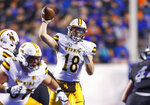 Wyoming quarterback Tyler Vander Waal (18) throws a pass against Boise State during the first half of an NCAA college football game Saturday, Nov. 9, 2019, in Boise, Idaho. (AP Photo/Steve Conner)